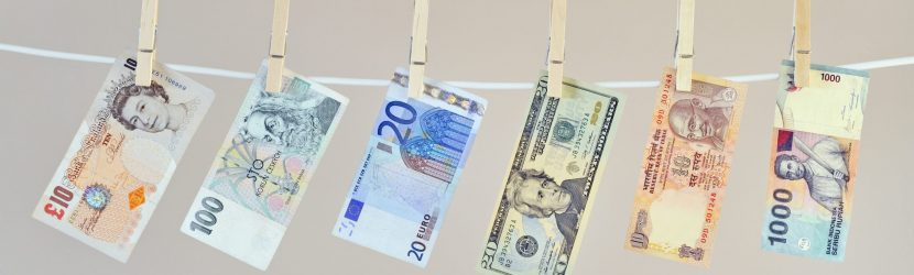 Money laundering concept, banknotes hanging on washing line